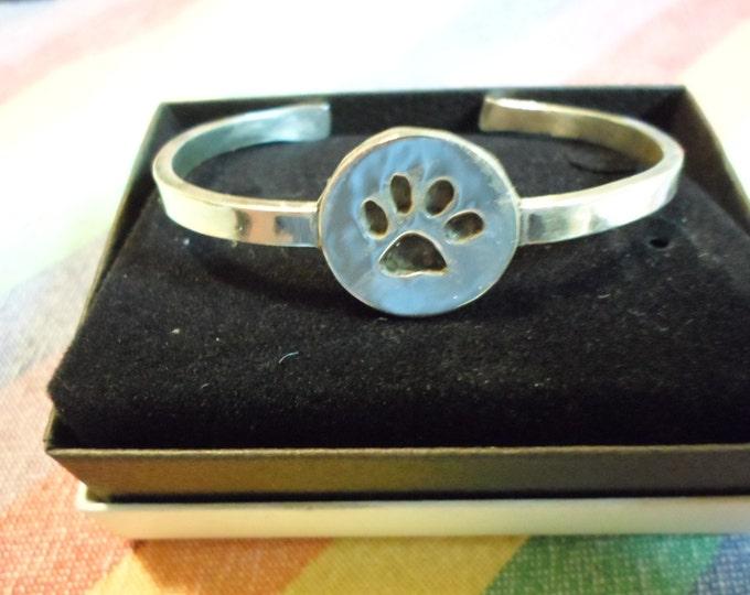 dog paw dime size cuff bracelet