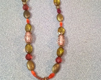 Tribal vintage beaded necklace with teardrop pendant.