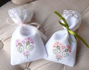 two hand embroidered sachets filled with Lavender