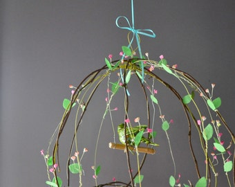 Twisting vines birdhouse...  green parakeet finds a home