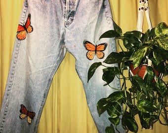 Hand painted butterlies on denim pants