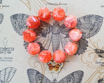 Swirled Orange Marmalade Beaded Stretch Bracelet with Gold Metal Spacer Beads & Orange and Black Butterfly Charm with Rhinestones+Gold Back
