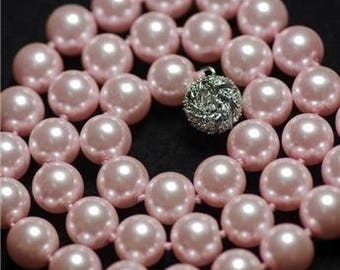 4 ROSE 10 MM ROUND SHELL BEADS.