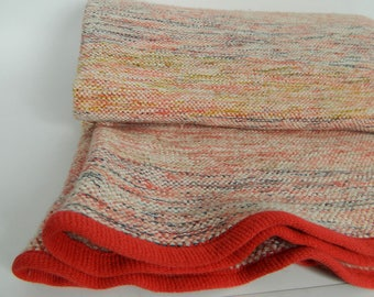 Pink blanket woven by the skilled artisan
