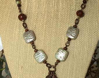 Light green Czech glass wavy squares, copper,and wood necklace