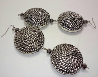 Silver tone dangling earrings