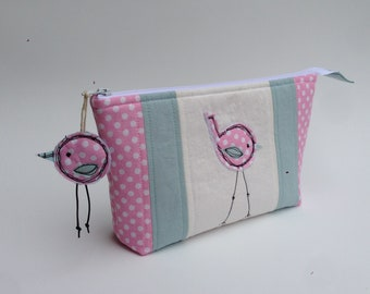 pink and aqua embroidered bird cosmetics pouch