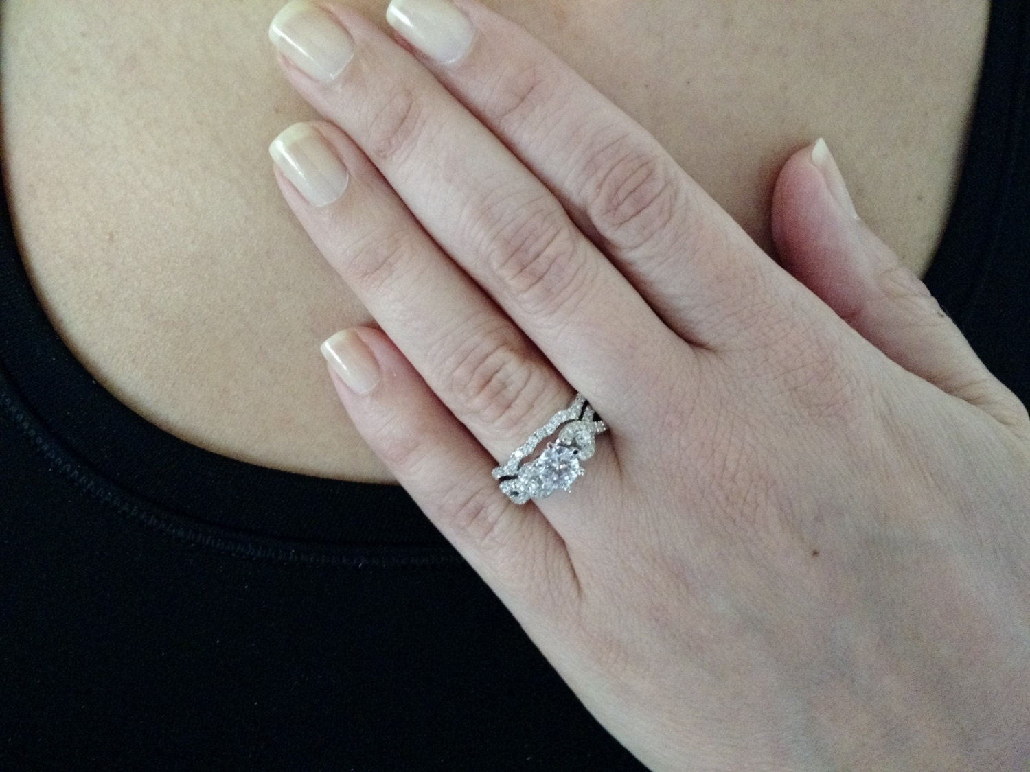 This is a unique diamond engagement and wedding band set featuring .78 carats of diamonds. The diamonds on the engagement ring are set in a pretty infinity shap