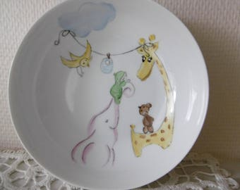 Digs gift hand painted porcelain plates: a pink elephant, baby, a griafe, a teddy bear and a bird.