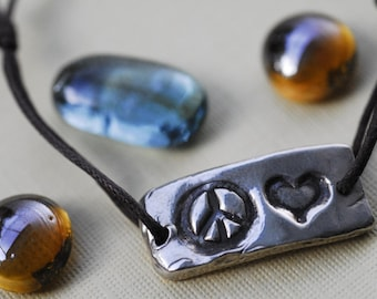 Sterling Silver Peace and Heart Bracelet