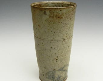 Wood fired cup with ash glaze and pigs