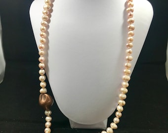 Beautiful necklace of pearls cultivated with bronze appliques