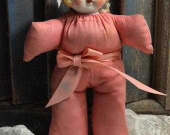 Vintage stuffed doll with ceramic head