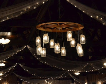 Rusticchandeliers on etsy alternating wagon wheel mason jar chandelier large mozeypictures Image collections