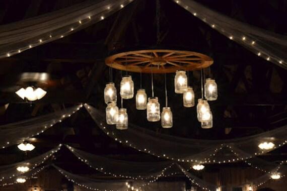 Alternating wagon wheel mason jar chandelier large aloadofball Image collections