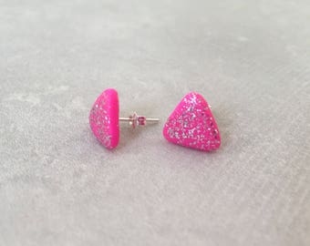 Hot pink triangle stud earrings with silver glitter