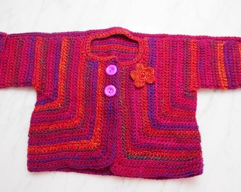 Crocheted Cardigan/Jacket shades of Reds, Oranges and Purples/ finished a crocheted flower embellishment - 12 month size