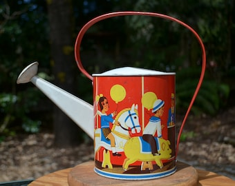 Wolverine Tin Watering Pitcher with Carousel Lithograph Image