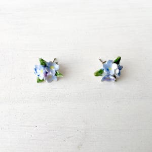 Ceramic floral earrings, Miniature floral stud earrings, Pansy flower, Blue, Purple, Silver tone backings.