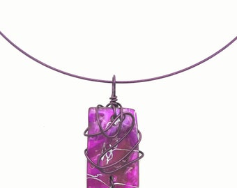 Purple and purple necklace that can be worn as a pendant on a cord or at the neck on a hoop