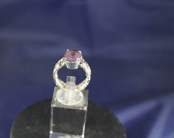Flex Ring A Custom Ring Featuring a Bezel Set Amethyst on a Byzantine Link Chain