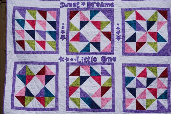 Baby Quilt - This handcrafted Applique quilt is the perfect gift for new baby or Toddler.  This bright design will add flare to any nursery