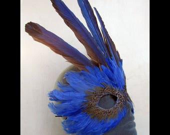 Dark Blue Mardis Gras Feather Mask Accented by a Crown of Macaw Wings and a hint of Gold