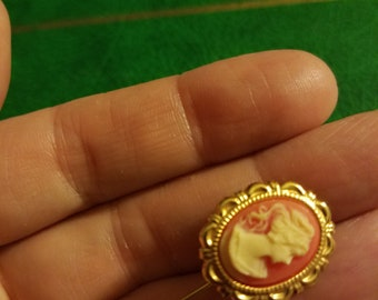 Victorian Revival cameo stickpin hatpin brooch extra long gold metal great condition faux angel skin coral molded carved resin