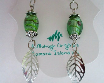 oblong green floral glass earrings with silver accents. Think spring :)