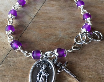Prayer bracelet, handmade with purple frosted glass beads, small crucifix with St Dymphna charm - or other saint medal/charm