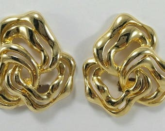 Vintage gold tone floral clip on earrings