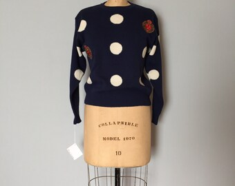 white circles navy blue sweater   crown wreath pullover