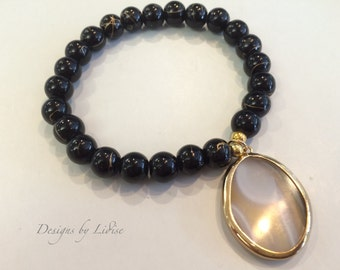 Black and Gold Beaded Bracelet with an Opal Drop Pendant