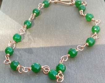 Anklet made using 6 mm faceted green quartzites. Hand linked using rose gold coloured silver plated copper wire.