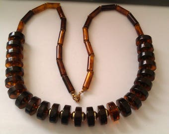 vintage amber coloured plastic bead necklace
