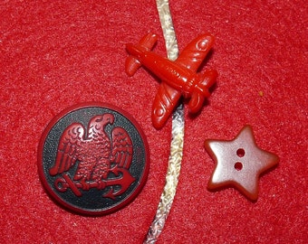 "Fun Group of ""Goofie"" Red Buttons, Plane, Bakelite Star, and a Red Eagle"