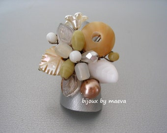 beige costume jewelry ring handcrafted beaded beige and white