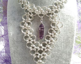 Necklace in silver plated rings and amethyst pendant