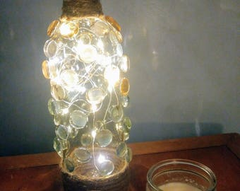 Recycled Wine Bottle with Lights inside decorated with Glass Stones and Twine