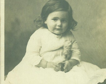 1916 RPPC Baby Girl Holding Toy Portrait Sepia Photo Photograph Real Photo Postcard
