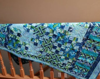 Lap/baby quilt dancing dragonflies in blues and greens.  41 x 61 inches.