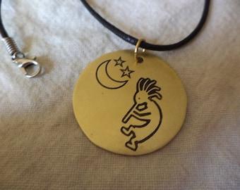 Kokopelli etched brass pendant
