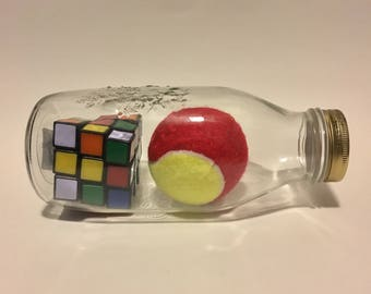 Impossible Bottle - Tennis Ball and Rubik's Cube in Milk Bottle
