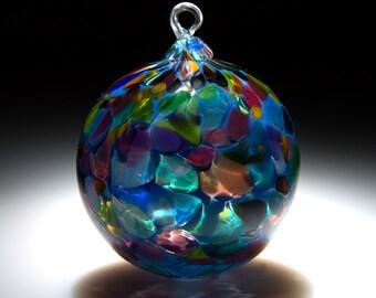 Ornament.  Sun catcher. Hand Blown Art Glass in Blue with Magic Mix.  Made in Seattle.  Artist Dehanna Jones.