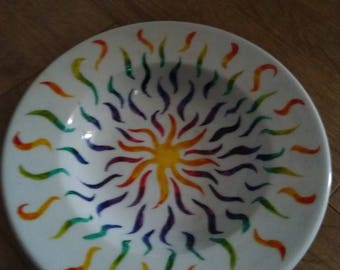 A hand painted white ceramic bowl
