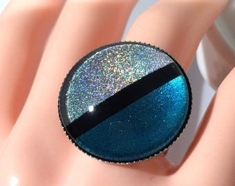 """Ring """"Diagonal"""", blue colors, black and """"Rainbow""""."""