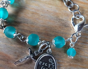 Prayer bracelet, handmade with sea blue turquoise frosted glass beads, small crucifix with St Dymphna charm - or other saint medal/charm