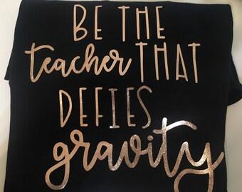 Be the Teacher that Defies Gravity Teacher Tee
