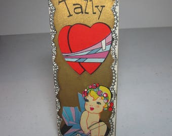 Adorable unused art deco 1920's-30's gold gilded valentine themed bridge tally card wrap around graphics of darling cherubic cupid hearts