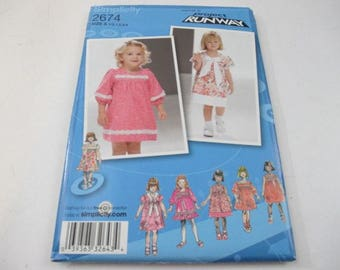 Simplicity Project Runway sewing pattern for toddlers' dress with sleeve and trim variations pattern 2674